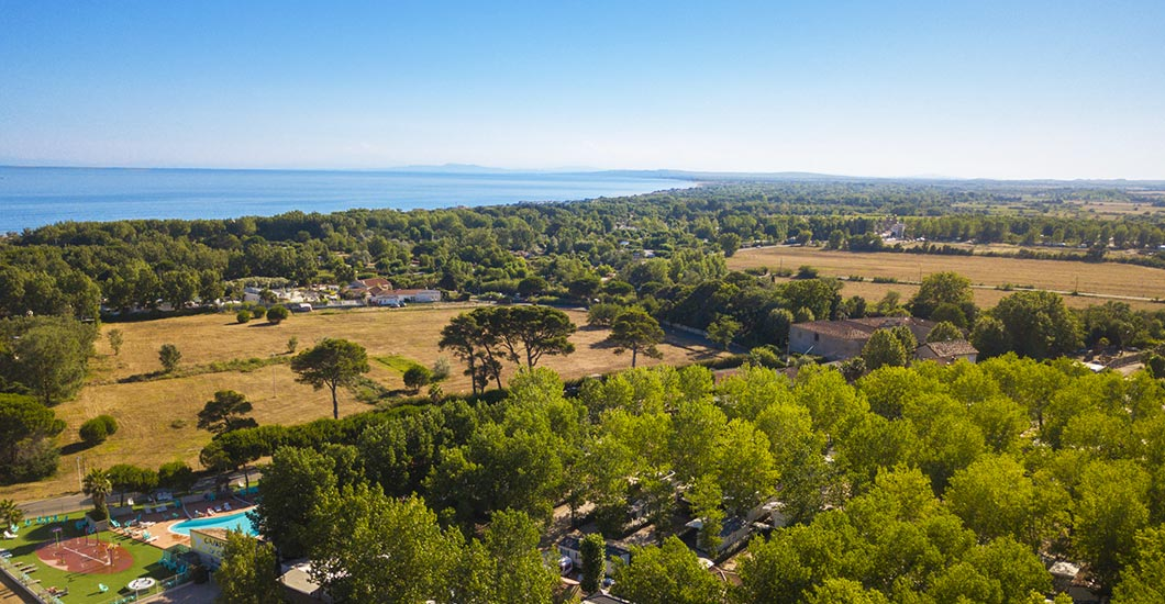 Between land and sea in Vias Plage beach drone view, wooded family campsite, holidays with children