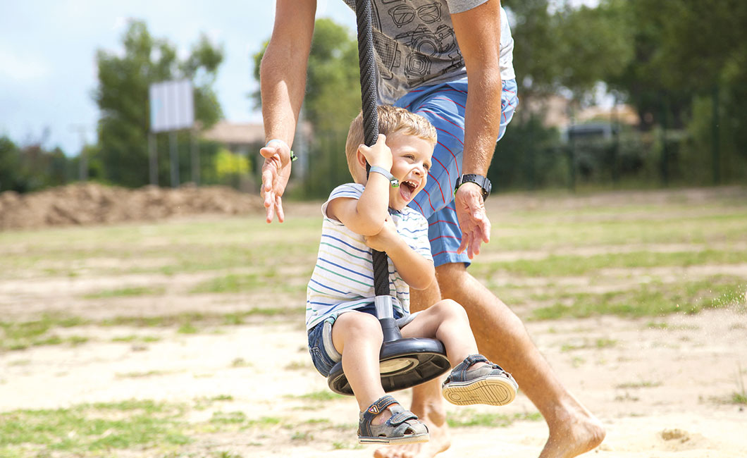 child having fun with his father, at the campsite Saint Cécile spend a family holiday in Vias plage