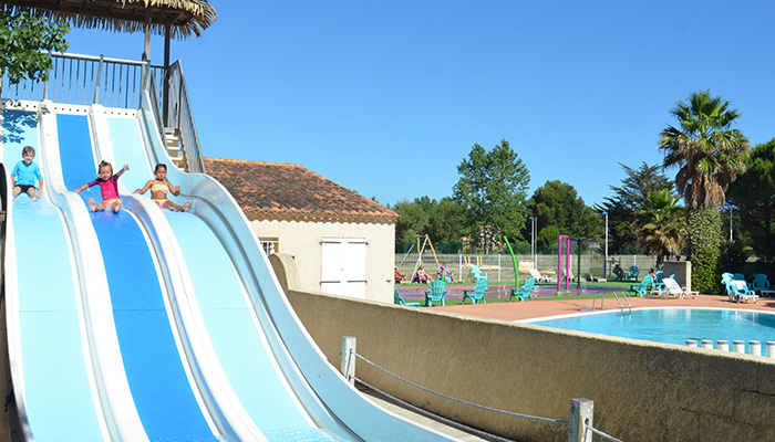 Yelloh Village swimming pool with slides, paddling pool, splashpad and tanning area