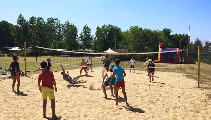 Beach volleyball court with sand  tournaments for teenagers and adults at camping saint Cécile