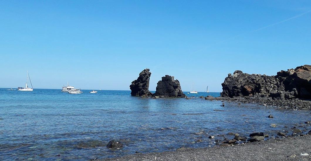 Beach, Cap d'Agde, 10 minutes driving from the campsite, dark sand beach